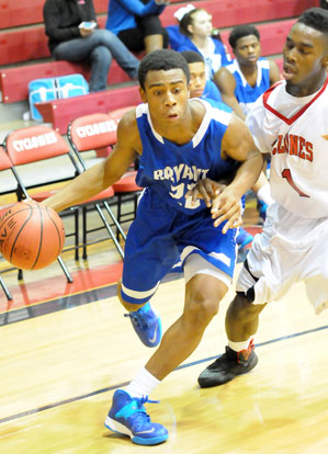 Freshman Romen Martin tries to drive past Russellville's Co-Chese Temple Laws. (Photo by Kevin Nagle)