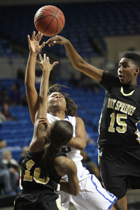 Jayla Anderson tried to get a shot off in traffic. (Photo by Rick Nation)