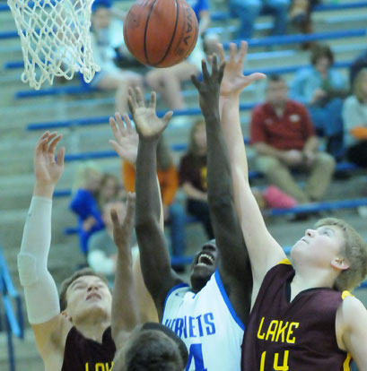 Bryant's Caylin Allen battles Lake Hamilton's Will Martin (14) and Noah Rengstorf for a rebound. (Photo by Kevin Nagle)