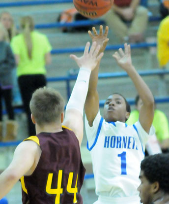 Tim Kelly (1) launches a shot over the out-stretched hand of a Lake Hamilton defender. (Photo by Kevin Nagle)