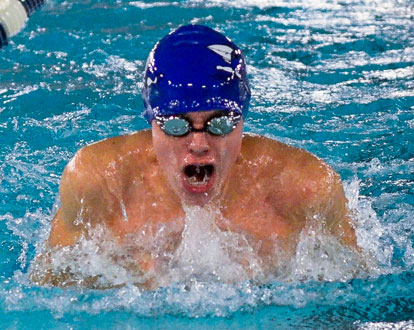 Christian Reep on his way to winning the 100 yard breast stroke. (Photo courtesy of Marianne Shelton)