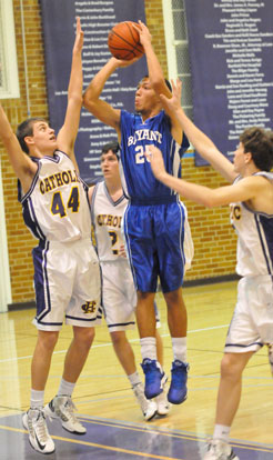 Jaelynn Jones (25) shoots over Little Rock Catholic's Drake Enderlin (44) and Chad Wharton (2). (Photo by Kevin Nagle)