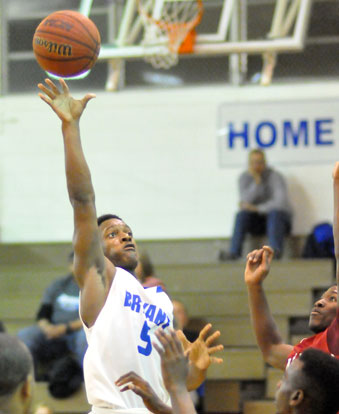 K.J. Hill goes high over a group of Texarkana players for a shot. (Photo by Kevin Nagle)