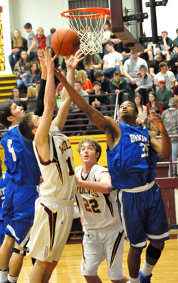 Brian Reed (35) and Luke Rayburn (4) battle for a rebound. (Photo by Kevin Nagle)