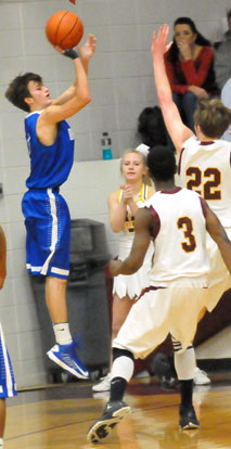 Tyler Simmons launched a 3 over Lake Hamilton's Harrison Watkins. (Photo by Kevin Nagle)
