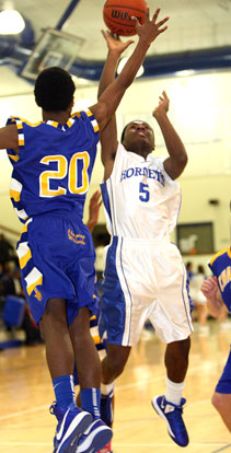Kris Croom (5) shoots over Rokar Williams. (Photo by Rick Nation)