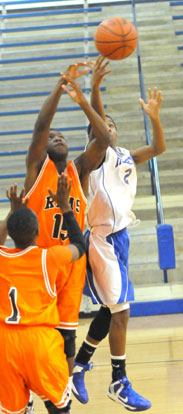Desmond Duckworth (2) scoops up a shot. (photo by Kevin Nagle)