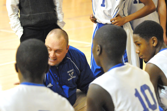 Bryant Blue head coach Derek McGrew talks to his team during a timeout. (Photo by Kevin Nagle)