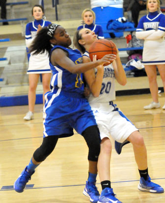 Kailey Nagle is fouled on the way up for a shot. (Photo by Kevin Nagle)