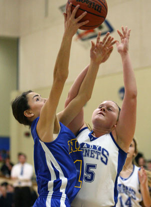 Bryant's Anna Turpin (25) battles for a rebound with North Little Rock's Reagan Sperling. (Photo by Rick Nation)