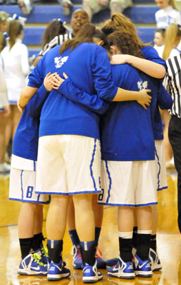 The Bryant seniors huddle before the game. (Photo by Kevin Nagle)
