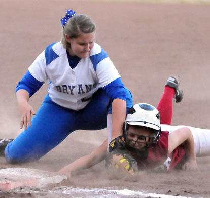 Kaley Coppock, left, applies a tag at first base. (Photo by Kevin Nagle)