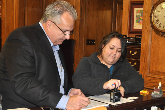 Lauren Copeland, an Ethics Compliance Officers in the Election Division of the Office of Secretary of State files Saline County Circuit Clerk Dennis Milligan's paperwork to form an exploratory committee for a 2014 race for Arkansas Treasurer.