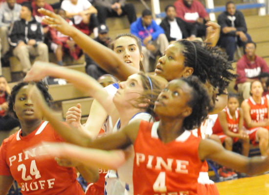 Courtney Davidson gets tangled up with a trio of Pine Bluff players in front of teammate Whitney Meyer. (Photo by Kevin Nagle)