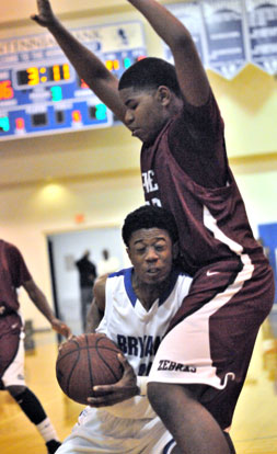 Bryant senior Strodney Davis tries to make some room against Pine Bluff's John Tate. (Photo by Kevin Nagle)
