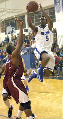 Bryant's K.J. Hill flies past a Pine Bluff defender on the way to the hoop. (Photo by Rick Nation)