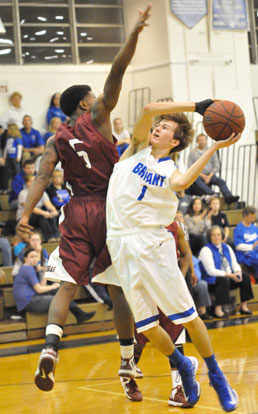 Tyler Simmons twists to try to get a shot past Pine Bluff's Derrick Rice. (Photo by Kevin Nagle)