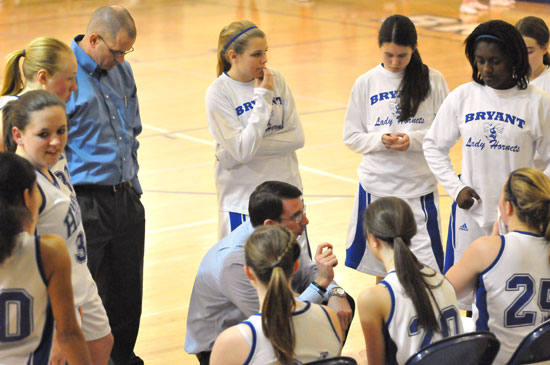 Bryant Lady Hornets freshman coach Nathan Castaldi instructs his team during a timeout. (Photo by Kevin Nagle)