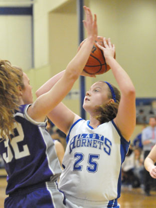 Anna Turpin (25) looks to shoot over Mount St. Mary's McKenzie Bridges. (Photo by Kevin Nagle)