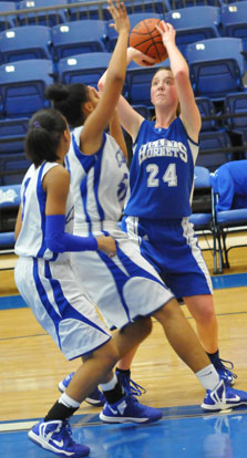 Britney Sahlmann (24) sets to take a shot over Conway Blue's Futra Banks. (Photo by Kevin Nagle)