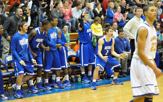 The Bryant bench celebrates a clutch 3-pointer by Tyler Simmons late in Friday's game at Sheridan. (Photo by Kevin Nagle)