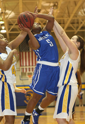 Dezerea Duckworth tries to get a shot away against a pair of Sheridan defenders. (Photo by Rick Nation)