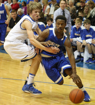 K.J. Hill drives past a Sheridan defender. (Photo by Rick Nation)
