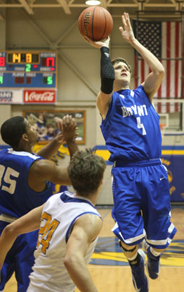 Luke Rayburn (4) goes up for a shot in front of teammate Brian Reed and Sheridan's Brady Bowlin. (Photo by Rick Nation)