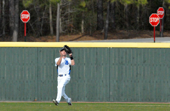 """Hayden Daniel """"stops"""" the Benton Panthers with a catch in right. (Photo by Kevin Nagle)"""
