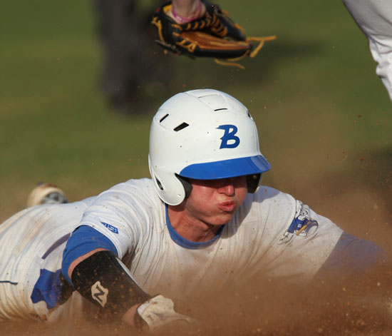 Bryant's Tyler Green dives back into first on a pickoff play. (Photo by Rick Nation)