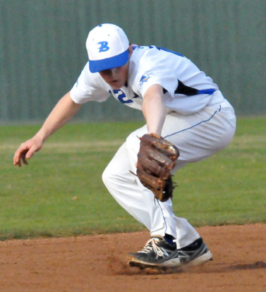 Trevor Ezell makes a back-handed stab in the hole at short. (Photo by Kevin Nagle)