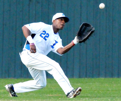 Marcus Wilson ranges to his left to haul down a liner to left. (Photo by Kevin Nagle)