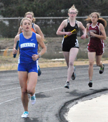 Talyn Billins turns the corner in the distance medley relay Thursday. (Photo by Kevin Nagle)