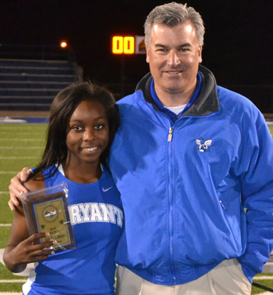 Bryant senior Alexis Royal received the high-point award from Bryant athletic director Mike Lee. (Photo by Vicki Westbrook)