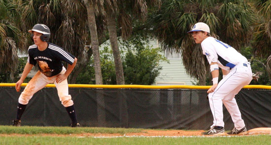 Bryant's Jason Hastings holds a St. Mark's base-runner at first. (Photo courtesy of J'Ann Boyd Lessenberry)