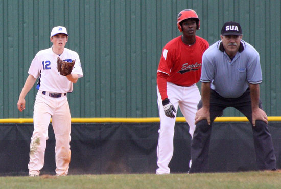 Bryant shortstop Trevor Ezell (12) holds a runner at second. (Photo by J'Ann Boyd Lessenberry)