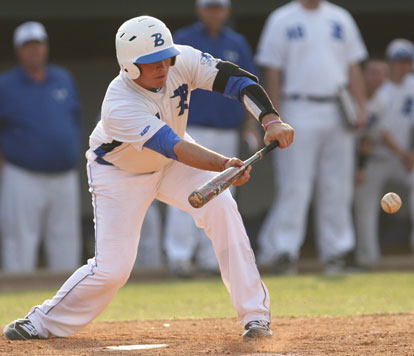 Hayden Lessenberry gets a bunt down. (Photo by Rick Nation)