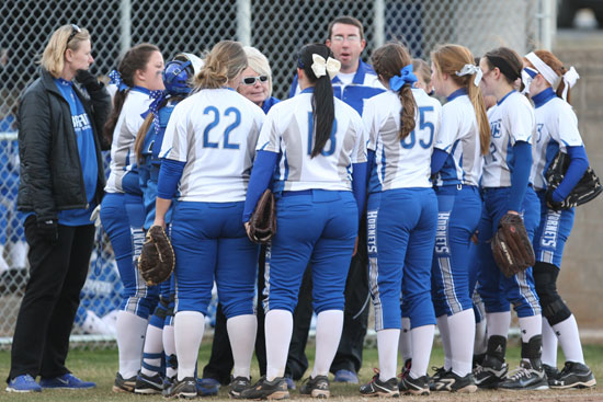 Bryant Lady Hornets coach Debbie Clark huddles with her team between innings. (Photo by Rick Nation)
