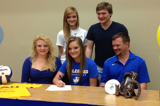 Hannah Rice, flanked by her parents Connie and Willie Rice, and her twin sister McKenzie and brother Aaron, signs her letter of intent with SAU.