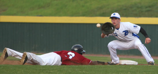 Ty Harris takes a pick-off throw as Pine Bluff's Aaron McDonald (3) dives back in to first. (Photo by Rick Nation)