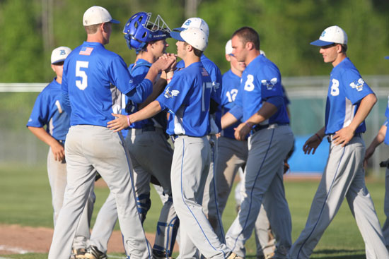The Bryant Hornets celebrate the final out of Thursday's win over Sheridan. (Photo by Rick Nation)