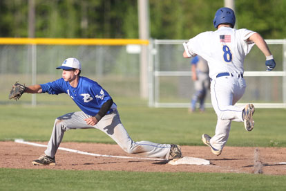 Ty Harris takes a throw to first in time to retire Sheridan's Ryan Taylor. (Photo by Rick Nation)