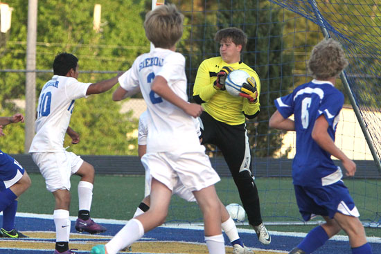 Bryant keeper Alex Denker secures the ball to thwart a Sheridan bid to score. (Photo by Rick Nation)