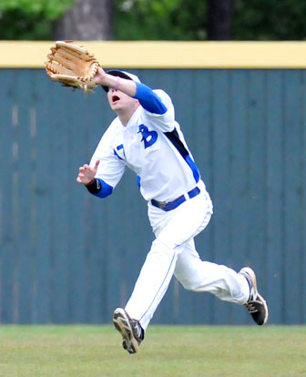 Left fielder Austin Caldwell tracks down a shallow fly. (Photo by Kevin Nagle)