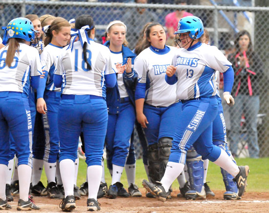 Sydney Gogus caps off her home run trot as her teammates await to greet her. (Photo by Kevin Nagle)