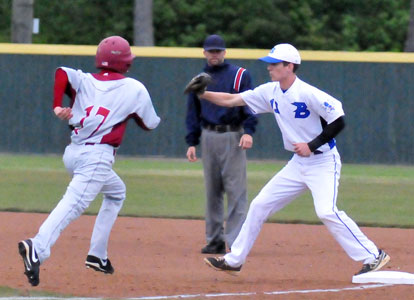 Ty Harris takes a throw at first to retire Texarkana's Steven Boyce (17). (Photo by Kevin Nagle)