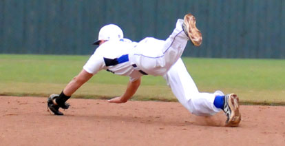 Korey Thompson saves a run with a diving stop in the second inning of Bryant's win over Texarkana. (Photo by Kevin Nagle)