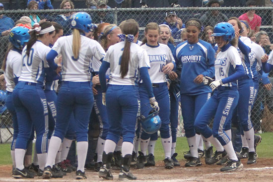 The Lady Hornets greet freshman Sierra Jones (15) after her first home run ever. (Photo by Rick Nation)