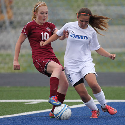 Bryant's Hailey Levinson battles with a Texarkana player for possession. (Photo by Rick Nation)