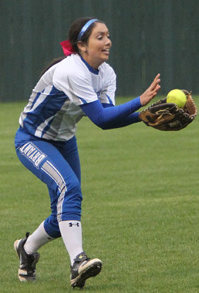 Carly Yazza makes a catch in left field. (Photo by Rick Nation)